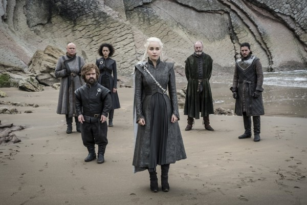 daenerys-targaryen-stands-on-the-beach-of-dragonstone-surrounded-by-her-advisors-plus-jon-snow-and-davos